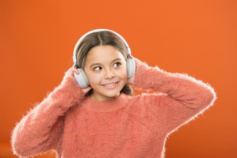 DJ, put the record on. Cute small child wearing DJ headphones. Little girl listening to music and dancing on silent stock photos