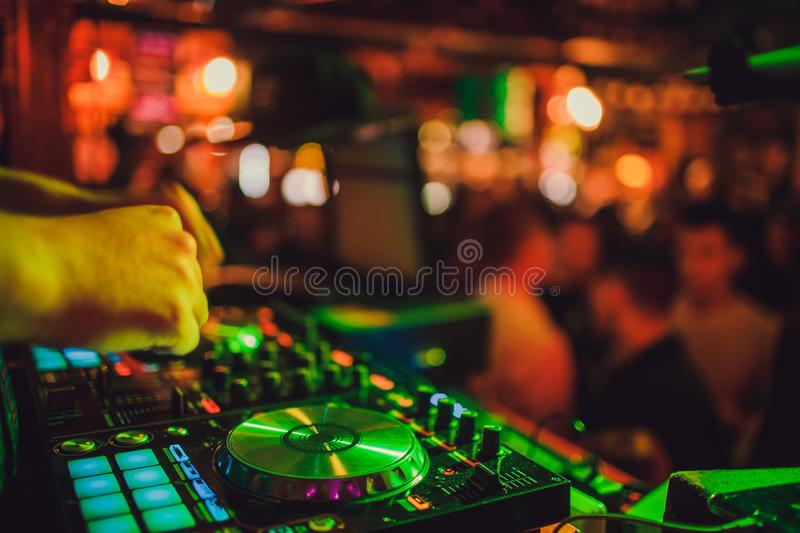 DJ remote, turntables, and hands . Night life at the club, party. stock photos