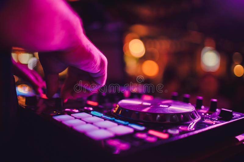 DJ remote, turntables, and hands . Night life at the club, party. stock image