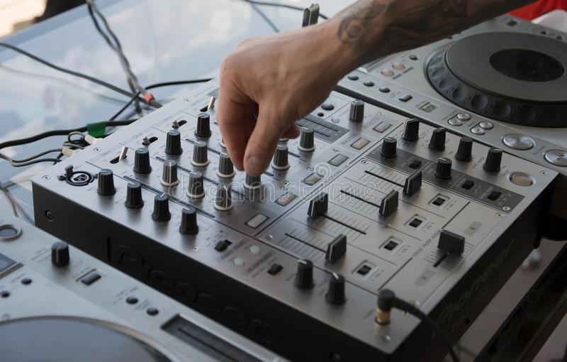 DJ`s hand on the music, control panel stock photo