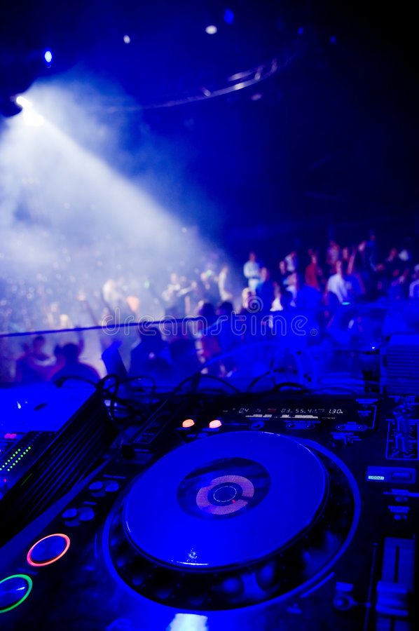 Dj's turntable. Blurred crowd on the background stock photos