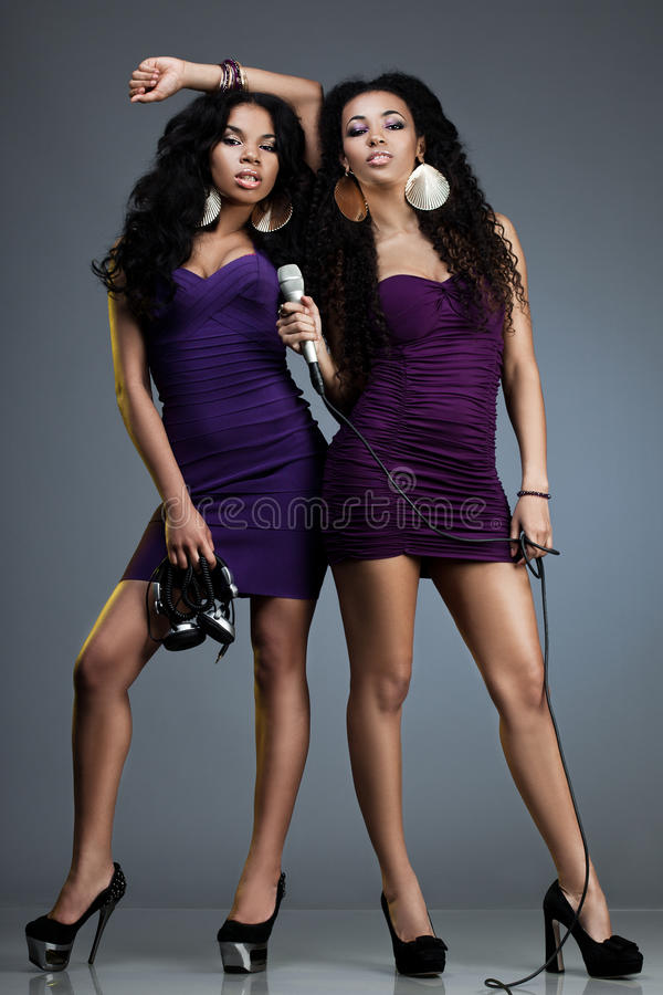 Dj and singer. Beautiful women – dj and singer royalty free stock image