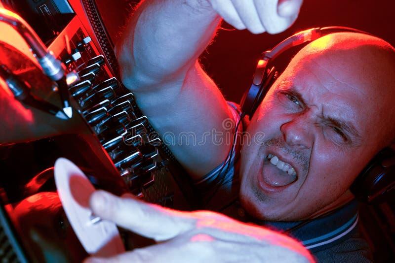 DJ smashing the decks stock image