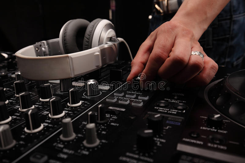 DJ sound equipment at nightclubs and music festivals, EDM, future house music and so on. closeup hands stock images