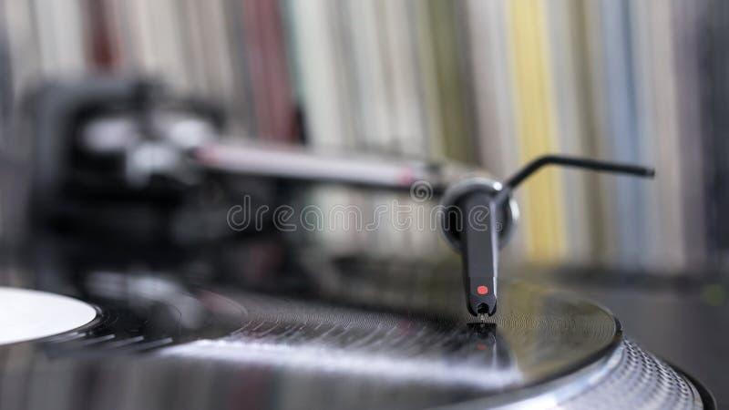 Dj stylus on spinning vinyl, record background. Dj needle stylus on spinning record, vinyl background stock images