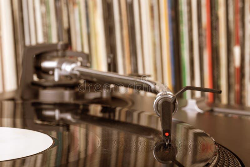 Dj stylus on spinning vinyl, record background. Dj needle stylus on spinning record, vinyl background stock photo