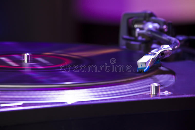 DJ turntable. Closeup of a record playing on the dj turntable stock image