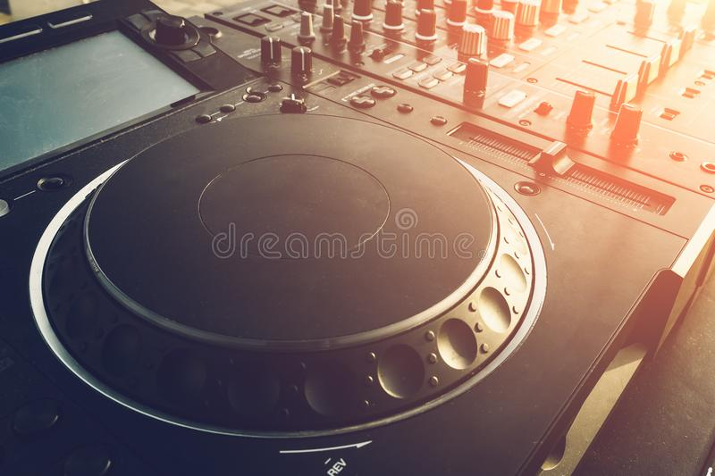 DJ turntable deck mixer close up, sound equipment, audio control panel for party, night clubs or music studio stock photo