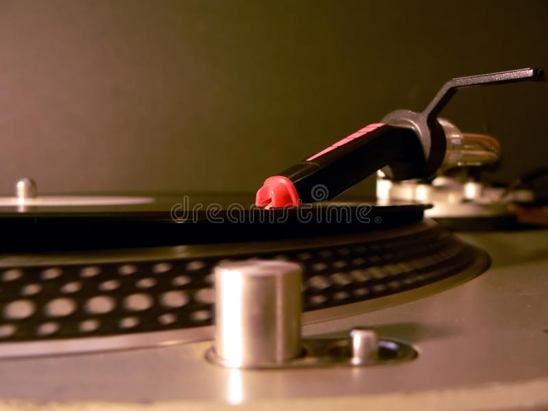 Dj turntable needle on record stock image