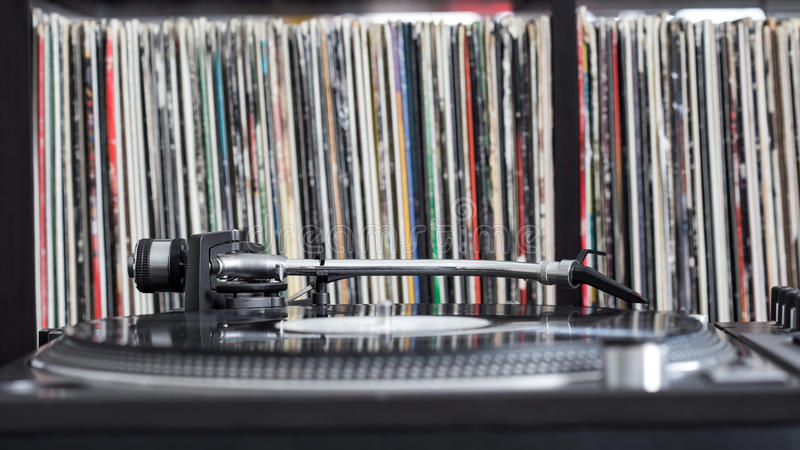 Dj turntable on vinyl background royalty free stock photo