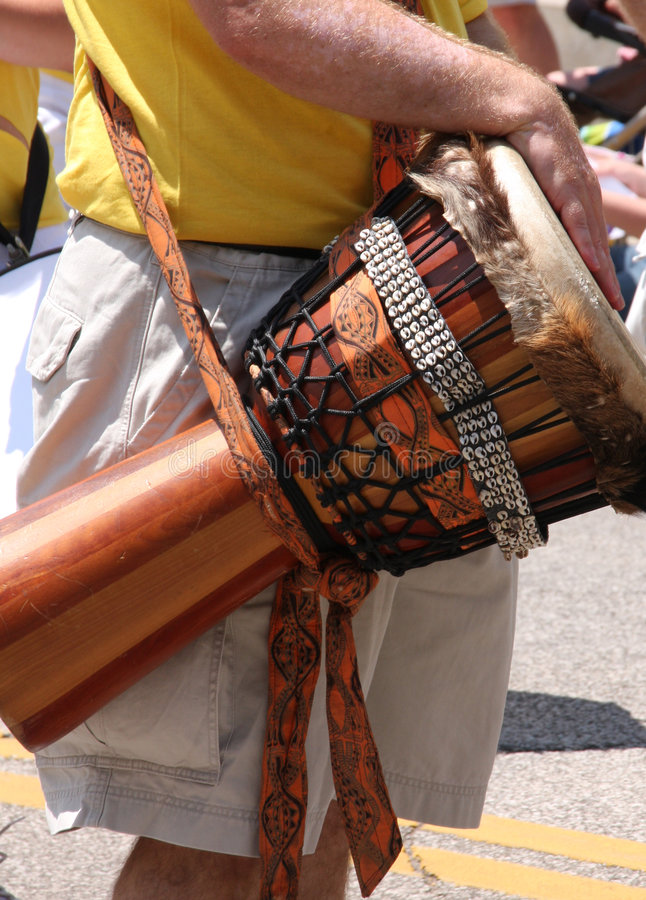 Djembe hand drum. A man playing a djembe hand drum royalty free stock photos