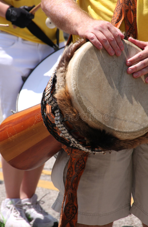 Djembe hand drum. A man playing a djembe hand drum stock images