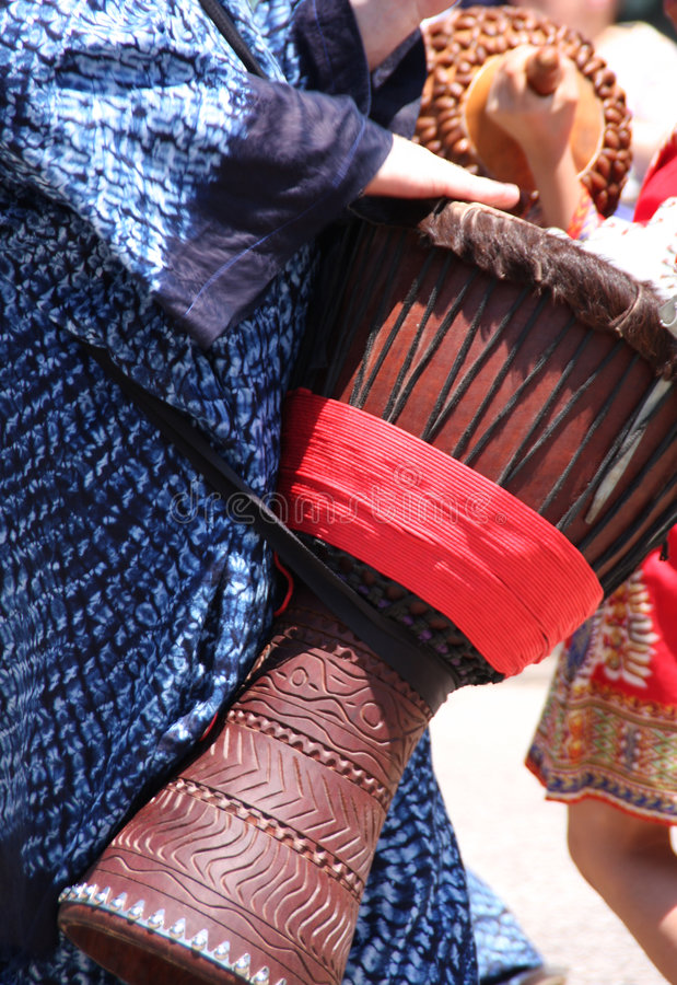 Djembe hand drum. A man playing a djembe hand drum royalty free stock photography