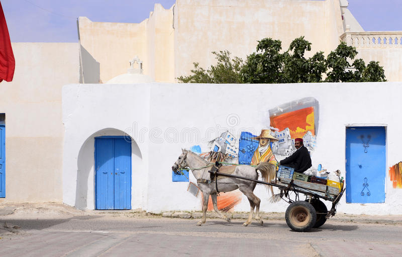Tunisia - Djerba Island, Man on Old Wagon with Colorful Graffiti Art. Graffiti art in Erriadh, a small village on the Tunisian island of Djerba royalty free stock photos