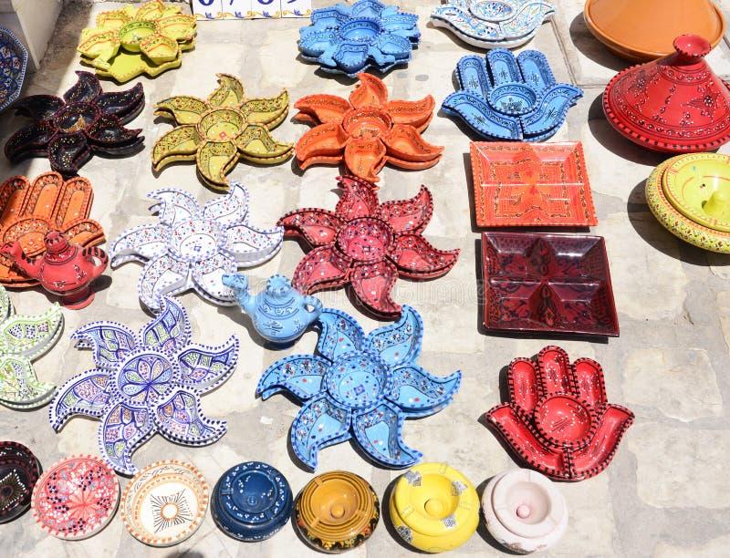 Djerba Market Colorful Earthenware, Arabic Pottery. Colorful plates, pots and ashtrays. Arabic earthenware for sail at Djerba street market stock image
