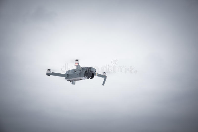 DJI Mavic Pro drone: Latvia March 8, 2017. Closeup of flying drone. royalty free stock images