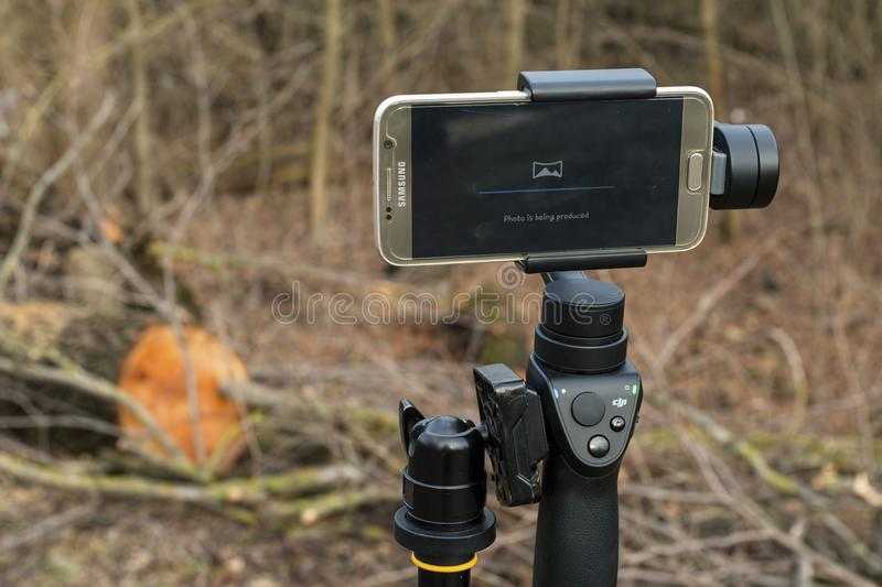 Download DJI Osmo Mobile Gimball Device And Samsung Galaxy S6 Phone. Editorial Stock Image - Image: 83702124