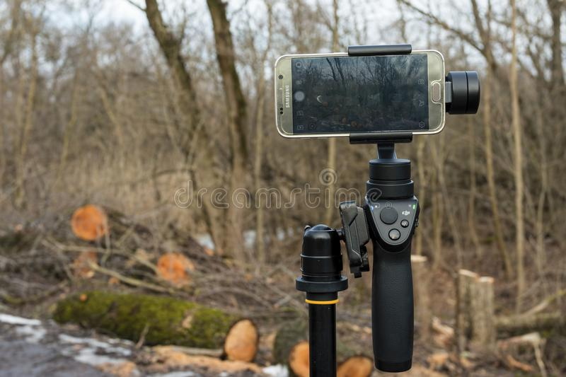 Download DJI Osmo Mobile Gimball Device And Samsung Galaxy S6 Phone. Editorial Photography - Image: 83702907