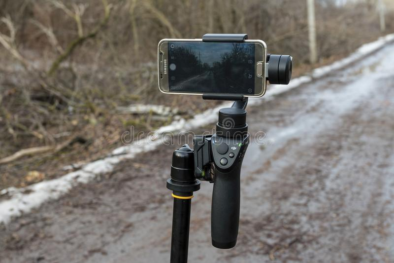 Download DJI Osmo Mobile Gimball Device And Samsung Galaxy S6 Phone. Editorial Photography - Image: 83703217