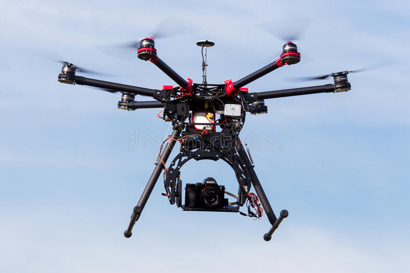 DJI S900 drone in flight with a mounted sony A7 Edition digital royalty free stock image