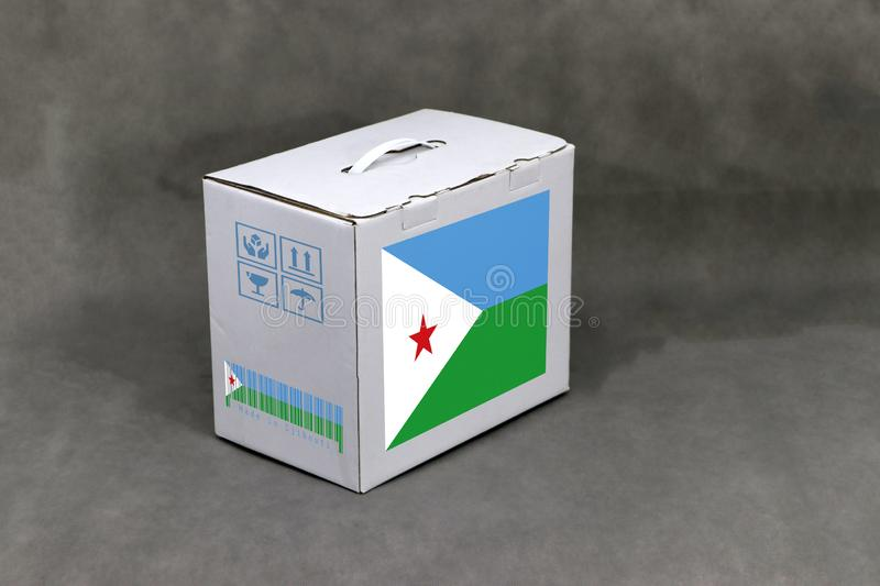 Djibouti flag on white box and nation flag barcode with fragile symbol. The concept of export trading from Djibouti. Paper packaging for put products stock images