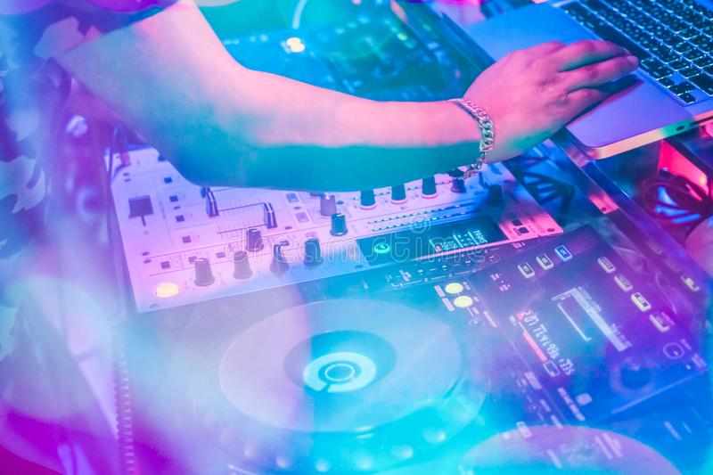 DJs are turntablism turntables plate mixer night party pub Motion blur wite light sunset abstract background. Instagram style filter photo vintage tone stock images