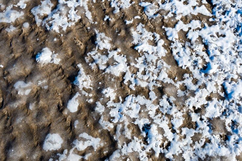 Djupfryst sand med iskvarter royaltyfria foton