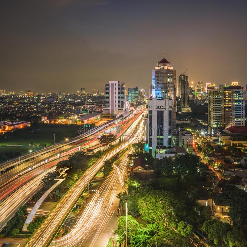 DKI Jakarta City Indonesia at Afternoon Cloudy Sky. The streets in Jakarta City with a Beautiful Night Hours around the Pancoran monument inner toll ring road in royalty free stock image