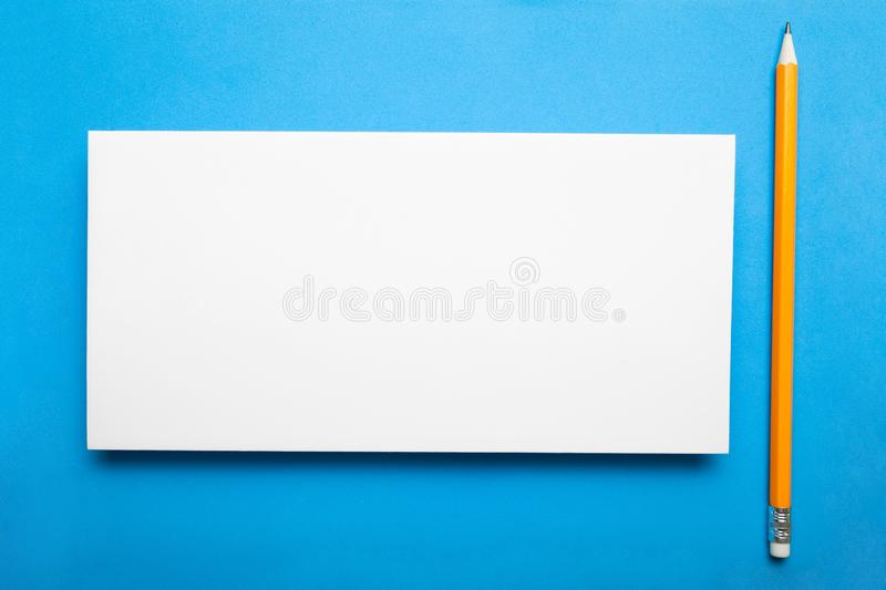 Dl flyer white template paper on blue background.  royalty free stock photos
