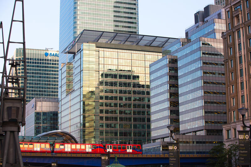 DLR train running through the Canary Wharf business and banking aria, London. LONDON, UK - SEPTEMBER 9, 2015: DLR train running through the Canary Wharf business royalty free stock images