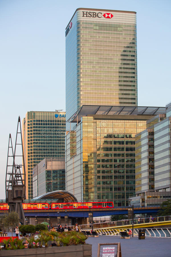 DLR train running through the Canary Wharf business and banking aria, London. LONDON, UK - SEPTEMBER 9, 2015: DLR train running through the Canary Wharf business stock images