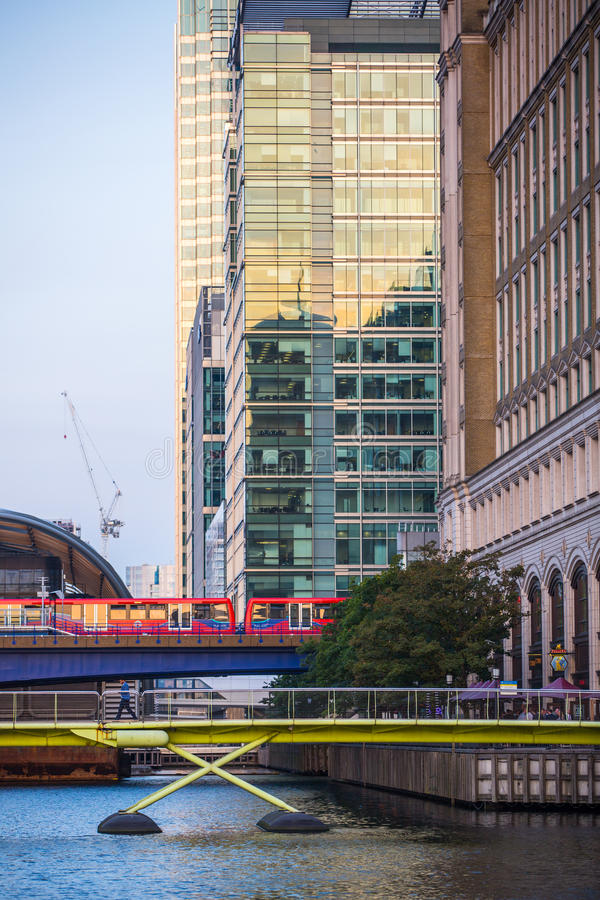 DLR train running through the Canary Wharf business and banking aria, London. LONDON, UK - SEPTEMBER 9, 2015: DLR train running through the Canary Wharf business stock photo