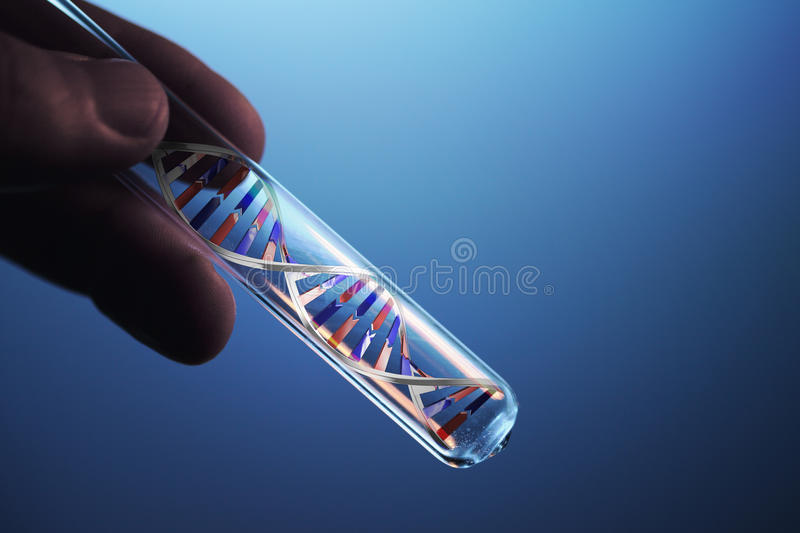 Dna molecule in test tube stock photography