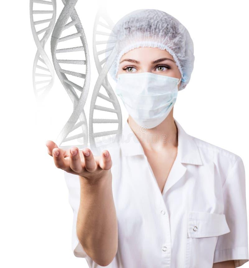 DNA przykuwa przepływy od ręki młoda kobiety lekarka zdjęcie stock