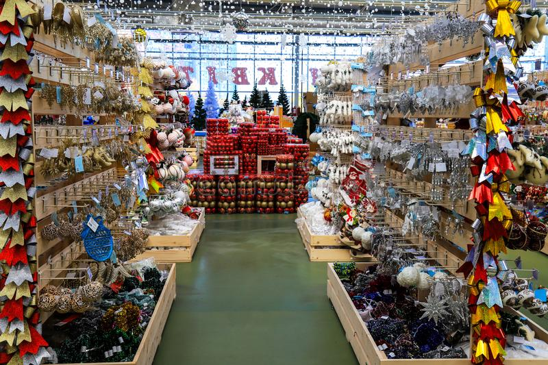 Shopping center with Christmas and New Year toys, rows of shop with festive decorations stock photo