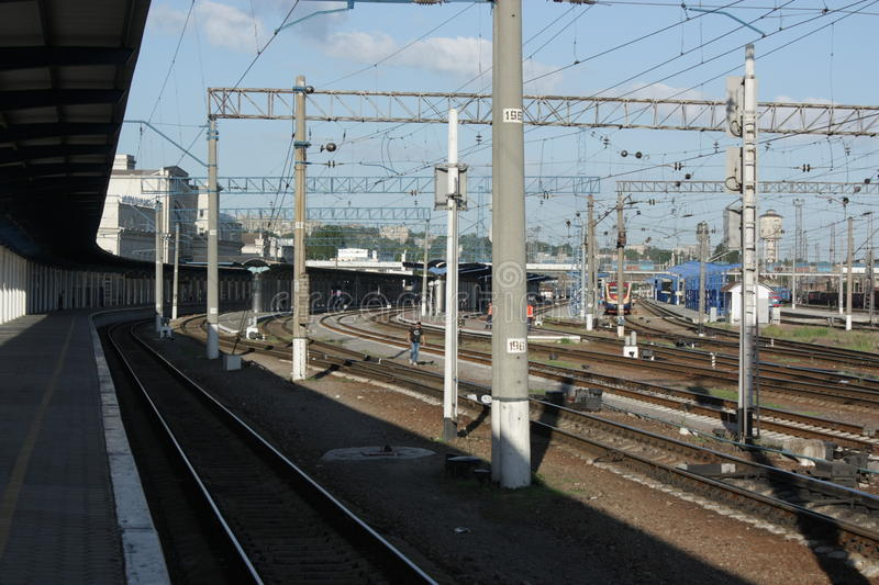 The Dnepr railway station platforms. With a couple of trains near stock photo