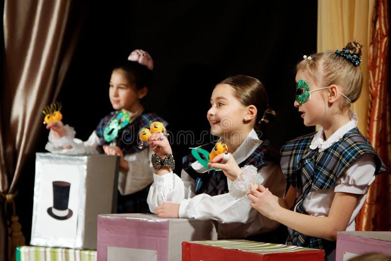 Funny game in children show. DNEPROPETROVSK,UKRAINE - MARCH, 2012- Artists of Children theatre perform in a music show Scotish ballads stock photos