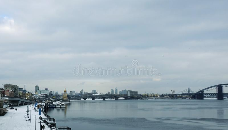 The Dnieper River in Kiev in winter. The Dnieper River in Kiev in the winter on a cloudy day stock photography
