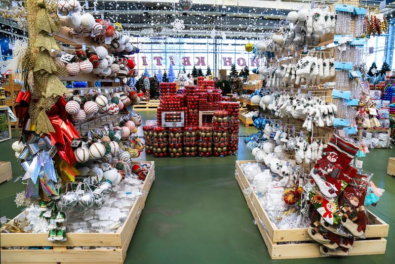 Mall with Christmas and New Year beautiful toys, rows of shop with festive decorations, winter holiday shopping . royalty free stock photo