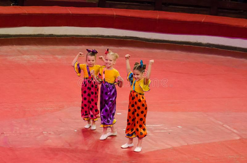 Circus show a bright arena. DNIPRO, UKRAINE - DECEMBER 9, 2017: Unidentified girls, age 9 years old, perform gymnastics at the Dnipro circus stock image