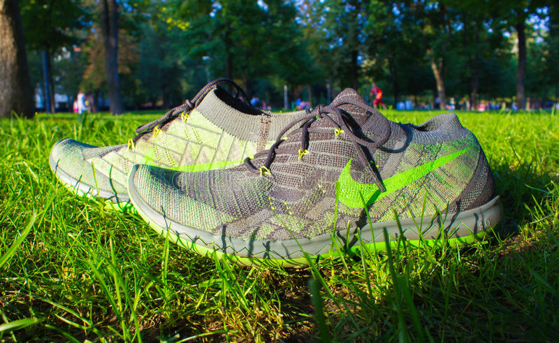 Dnipropetrovsk, Ukraine - August, 21 2016: New style nike shoes on green grass - illustrative editorial. Dnipropetrovsk, Ukraine - August, 21 2016: New style stock images