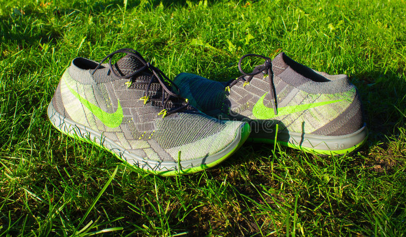 Dnipropetrovsk, Ukraine - August, 21 2016: New style nike shoes on green grass - illustrative editorial. Dnipropetrovsk, Ukraine - August, 21 2016: New style royalty free stock photo