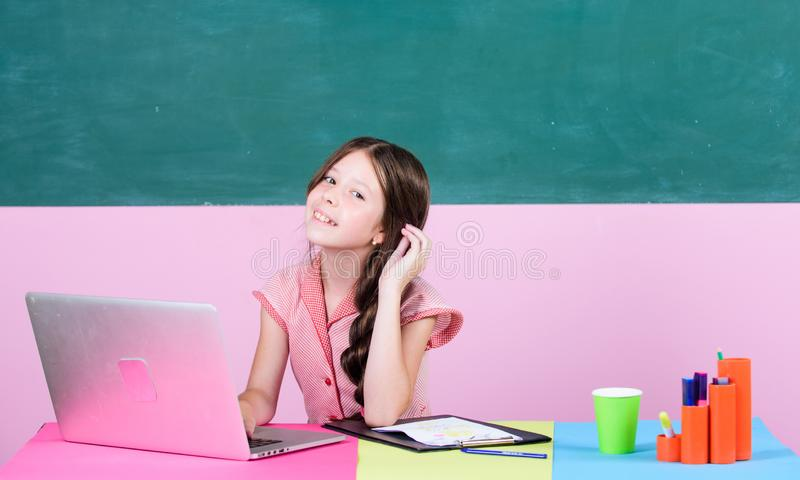 Do homework or play games. Watching video lessons. Online school. Online schooling. Distant education. Pupil study. Digital technology. Educative content royalty free stock photos