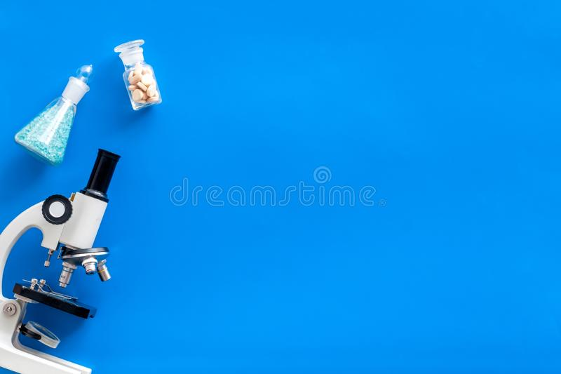 Do medical research with microscope, test-tubes in lab on blue background top view mock-up. Desk of doctor. Do medical research with microscope, test-tubes in royalty free stock images