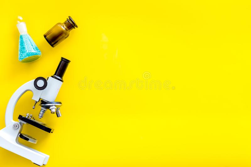 Do medical research with microscope, test-tubes in lab on yellow background top view mock-up. Desk of doctor. Do medical research with microscope, test-tubes in royalty free stock image