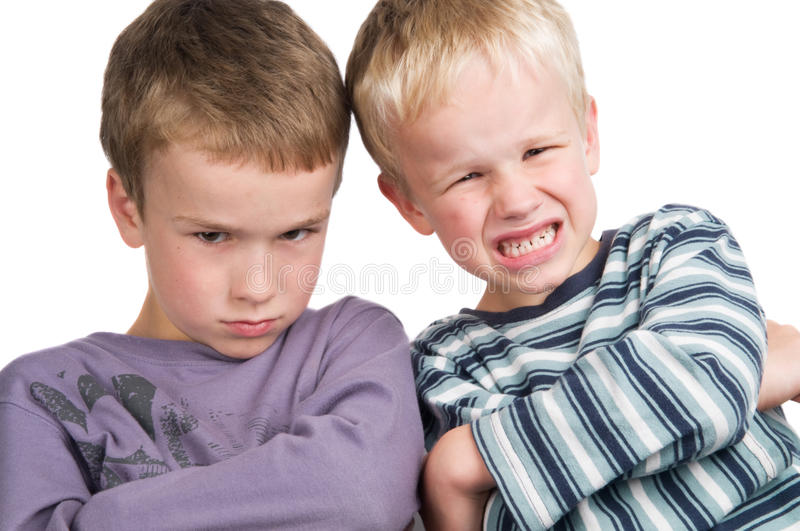 We do not agree. These two brothers do not agree royalty free stock photography
