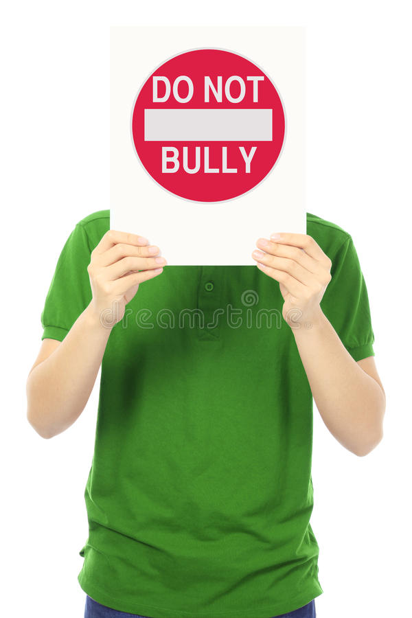 Do Not Bully. A teenager holding up a Do Not Bully sign stock photography