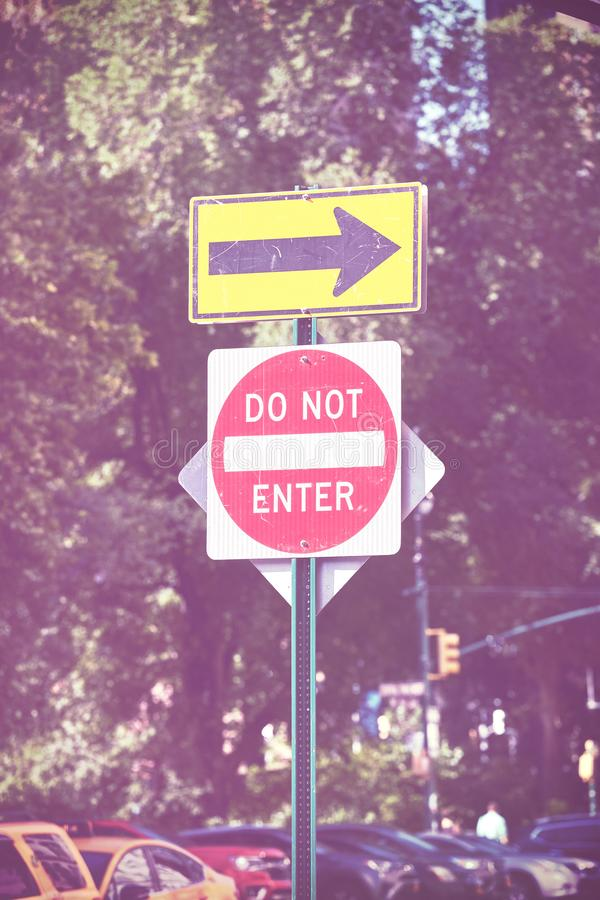 Do not enter and direction arrow street signs. Do not enter and direction arrow street signs, color toned picture stock images