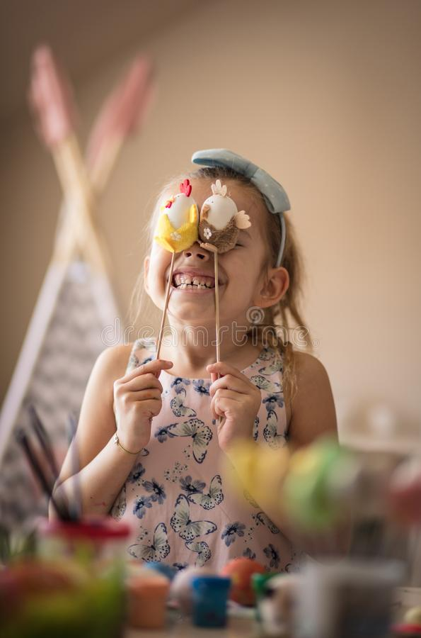 Do not hide your Easter joy. Little girls coloring Easter egg stock photos