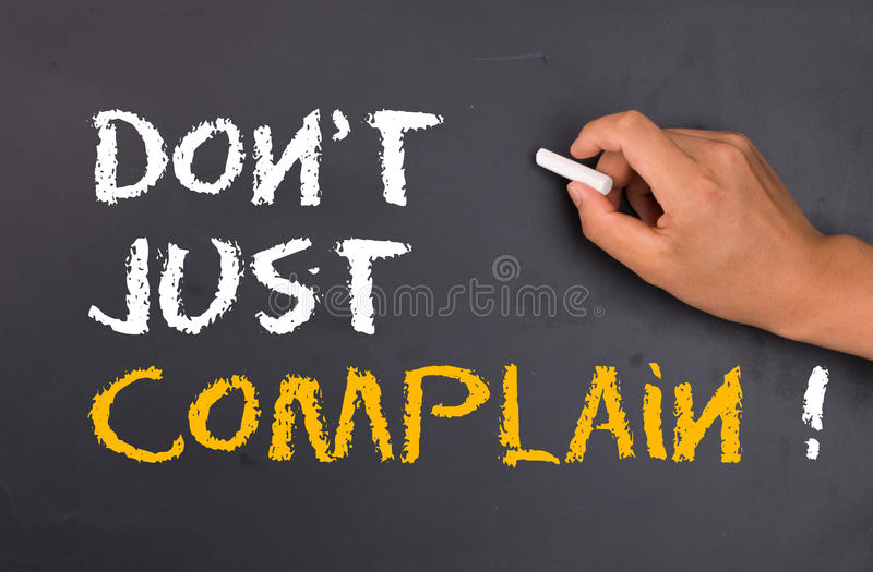 Do not just complain. Concept on chalkboard stock photo